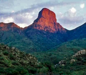 Baboquivari Peak is a 7,730-foot (2,356-meter) granite monolith located about 60 miles west of Tucson in southern Arizona. It can be seen along the scenic incline drive to the Kitt's Peak National Observatory. The peak is considered the most sacred mountain of the Tohono O'Odham tribe. Reaching the top can only be accomplished through technical rock climbing. The people believe the Holy Spirit lives on this mountain and only the determined Spiritual Warriors are able to complete the climb.